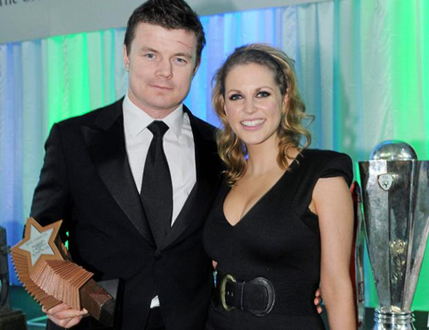 Ireland's rugby hero Brian O'Driscoll was last night chosen as the IrishIndependent Sportstar of the Year in association with the Croke Park Hotel . Brian and his fiancee, Amy Huberman, are pictured with his award at last night's gala banquet in Dublin where the achievements of top sports people were celebrated