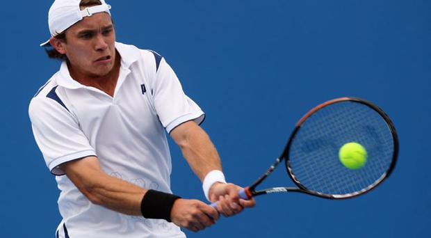 Louk Sorensen playing against Taiwan's Lu Yen-Hsun during the Australian Open in Melbourne yesterday Photo: Getty Images