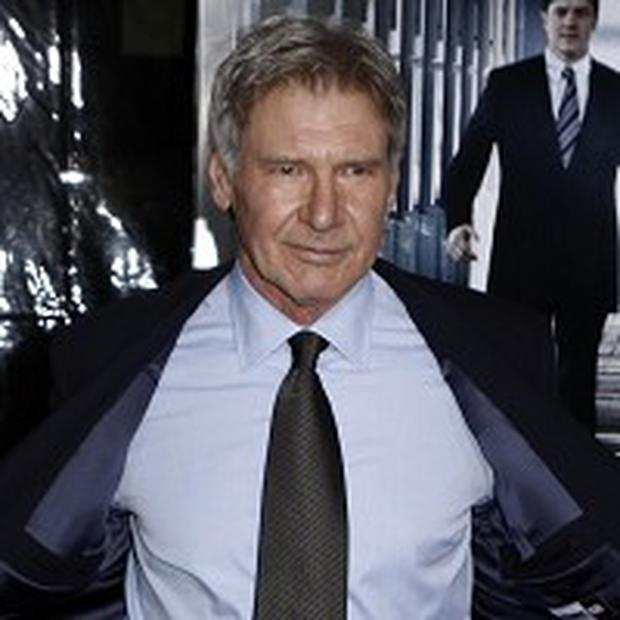 Harrison Ford attends the premiere Extraordinary Measures in LA