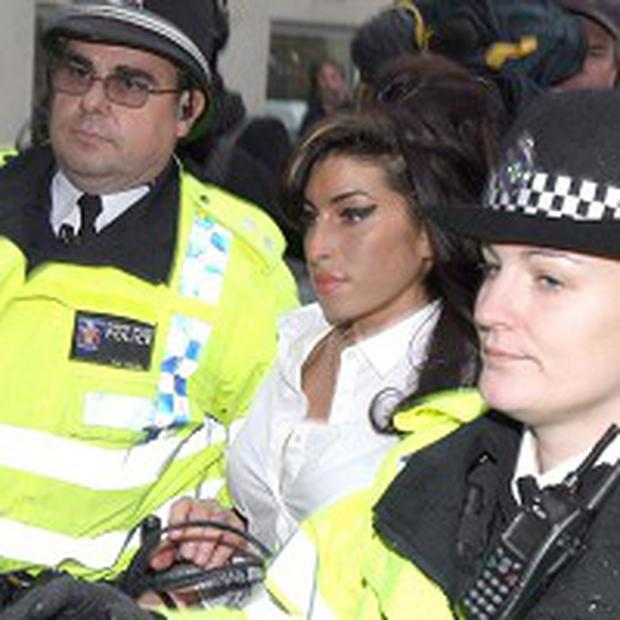 Amy Winehouse admitted assaulting a theatre manager