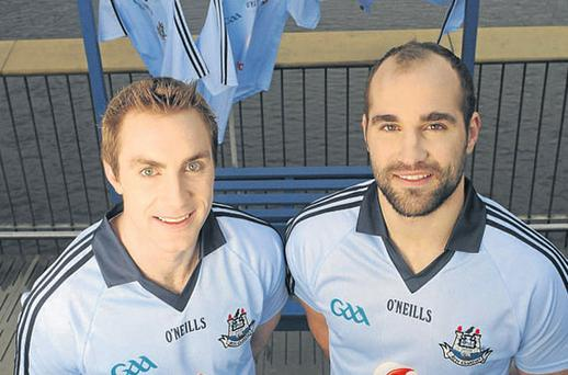 Dublin captains Paul Griffin (left) and Stephen Hiney sporting the county's new jerseys on the Liffey Boardwalk yesterday