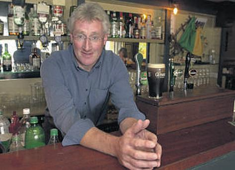 Pat Spillane behind his bar in Templenoe back in 2001