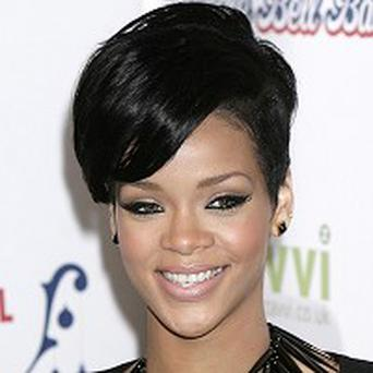 Rihanna to preform with Jay-Z, The Edge and Bono in London at today's 'Hope for Haiti' telethon.