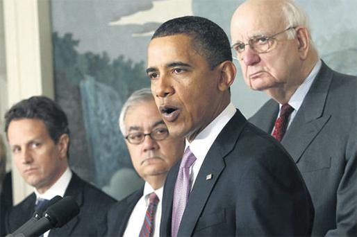 President Barack Obama speaks about financial reform after his meeting with Presidential Economic Recovery Advisory Board chairman Paul Volcker (right), Treasury Secretary Tim Geithner (far left) and Rep. Barney Frank (D-MA) at the White House yesterday