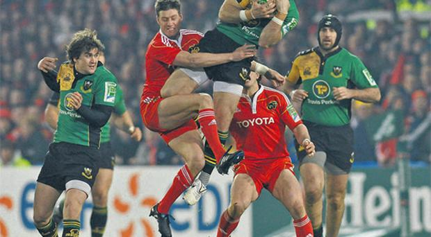 Munster's Ronan O'Gara contests a high ball with Ben Foden of Northampton Saints during last night's final Heineken Cup Pool 1 game at Thomond Park