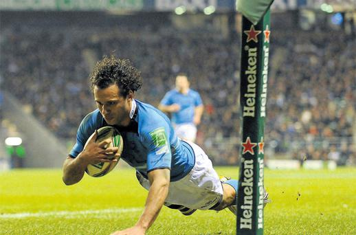 Isa Nacewa dives over for Leinster's try against London Irish in Twickenham yesterday