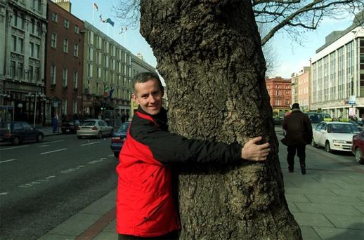 LOVE ME, LOVE MY TREE: Green Party TD for Dun Laoghaire Ciaran Cuffe gets touchy-feely in O'Connell Street during the controversy a few years ago over the proposed removal of the trees