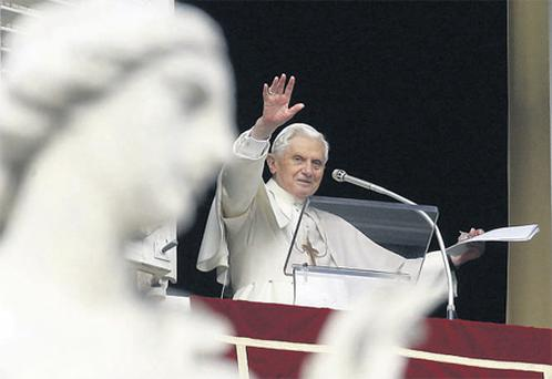 Pope Benedict XVI greets the faithful at the end of the Angelus prayer, in St Peter's Square, yesterday