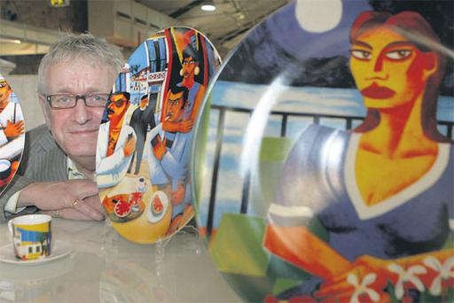 Artist Graham Knuttel with his new designs for Tipperary Crystal at Showcase Ireland which was held in the RDS, Dublin, yesterday.