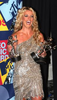 Britney Spears has donated the dress she wore to the 2008 MTV Video Music Awards for auction to help out Haitian earthquake victims. Photo: Getty Images