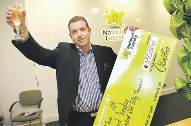 This is one cheque that you would not mind getting. Lotto winner Dermot Finglas from Drogheda pictured recently with his cheque for €350,000 at the National Lottery HQ in Dublin