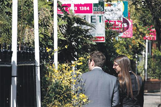 House hunters face a dilemma: do they hold out buying until property prices reach the bottom, or do they buy now and lock in to a low fixed rate mortgage deal as rates are set to rise this year?