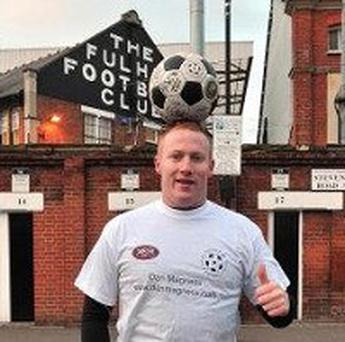 Dan Magness stands outside Fulham Football club before his world-record bid
