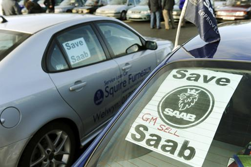 A banner is stuck in the back window of a Saab during a 'Save Our Saab' support event meeting in Luton on January 17. Photo: Getty Images
