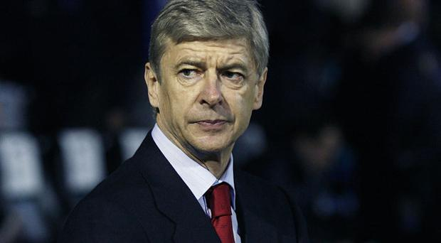 Arsene Wenger believes Arsenal will be well placed in the title race at teh end of a daunting run of fixtures Photo: Getty Images