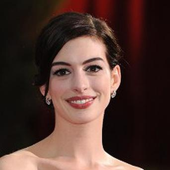 Anne Hathaway will help announce the Oscar nominations next month
