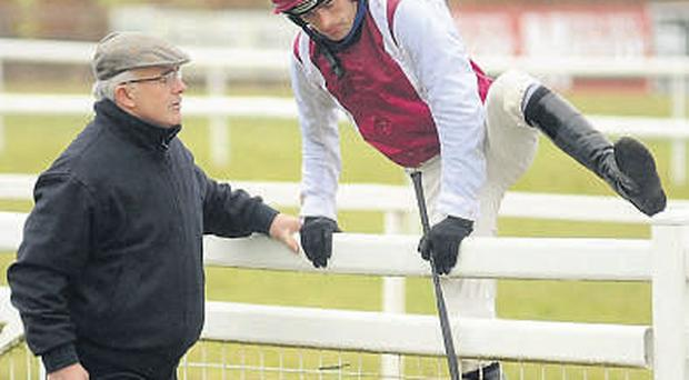 Ruby Walsh jumps over the railing to meet his father, Ted, after Seabass fell at the last fence with the Navan Handicap Steeplechase at his mercy. HEALY RACING