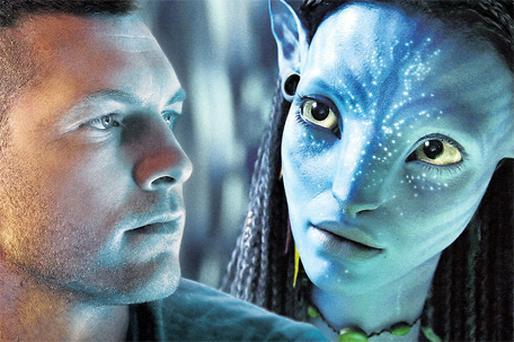 Actors Sam Worthington and Zoe Saldana, as her digital character Neytiri, in a scene from 'Avatar' - the highest grossing film of all time