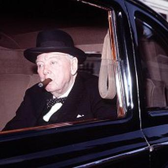 Sir Winston Churchill smoking his trademark cigar in 1964
