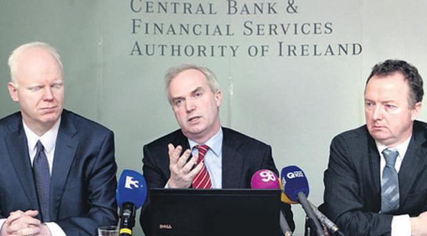 Economists, from left, Gerard O'Reilly, Maurice McGuire, assistant director general, economic services, and John Flynn at the Central Bank quarterly report in Atlas House, Dame St., Dublin, yesterday.
