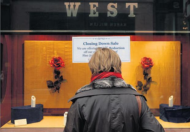 A sign on West Jewellers stating that it will be closing down.