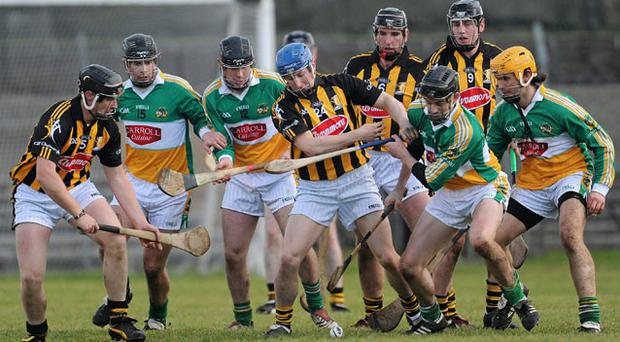 Kilkenny and Offaly's players scrap for possession during yesterday's Walsh Cup clash BRIAN LAWLESS / SPORTSFILE