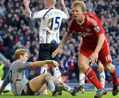 Dirk Kuyt celebrates scoring Liverpool's first goal on Saturday Photo: Getty Images