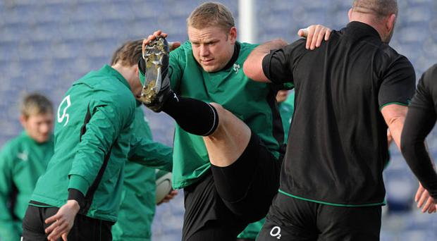 Ireland's Tom Court and John Hayes go through some stretching routines during training ahead of their opening Six Nations match against Italy on Saturday MATT BROWNE / SPORTSFILE