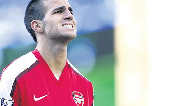 Arsenal skipper Cesc Fabregas believes his team must beat Chelsea on Sunday to maintain their title hopes