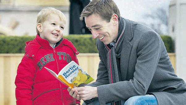 Ryan Tubridy and four-year-old Jack Sullivan read books by Irish authors at the Kellogg's Storytime promotion launch yesterday