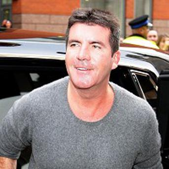 Simon Cowell brought stars together for the Haiti quake single