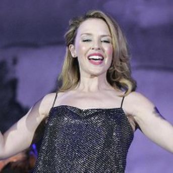Kylie Minogue donated a handbag to the Haiti auction