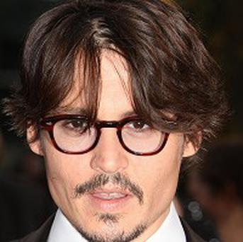 Johnny Depp's new Alice In Wonderland film will have a royal premiere