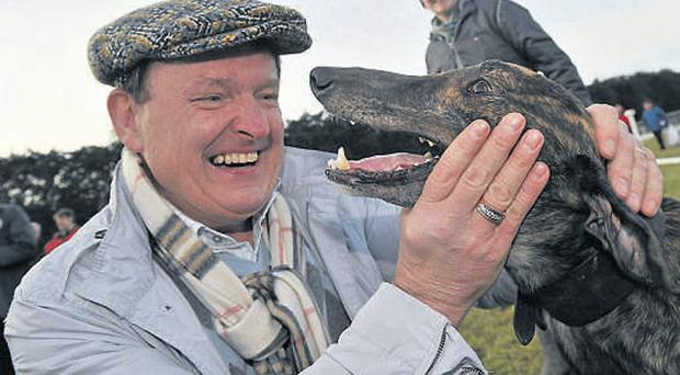 Joint owner Basil Holian with Adios Alonso after winning the Boylesports.com Derby at the National Coursing Meeting in Clonmel yesterday BRIAN LAWLESS / SPORTSFILE