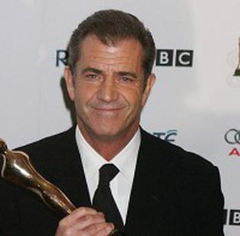 Mel Gibson has denied swearing at a reporter