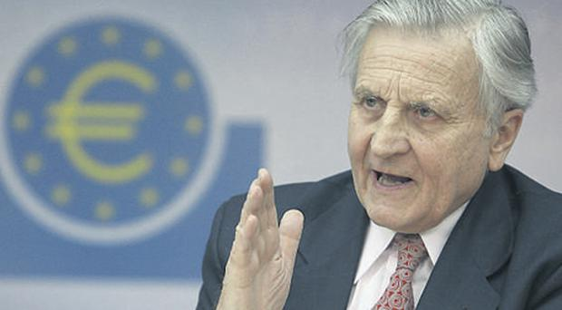 Jean-Claude Trichet, president of the European Central Bank, addresses the media during his monthly news conference at the ECB headquarters in Frankfurt yesterday