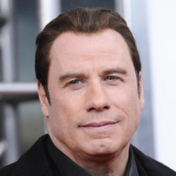 John Travolta says his dance background helped with doing his own stunts
