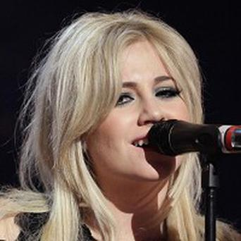 Pixie Lott wants to get a tattoo for her fans