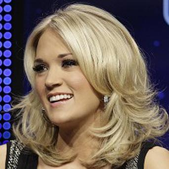 Carrie Underwood hopes she doesn't forget the words to the US national anthem