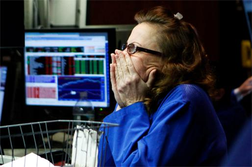 A trader watches a monitor on the floor of the New York Stock Exchange