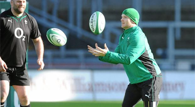 Ireland's Gordon D'Arcy works on his handling skills under the eye of John Hayes during during the squad's Captain's Run at Croke Park yesterday