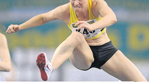 Derval O'Rourke, Leevale AC, on her way to winning the senior women's 60m hurdles final at the National Indoor Championships in Belfast yesterday