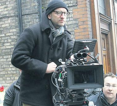 Steven Soderbergh dresses warmly while working the camera.