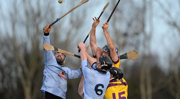 Dublin hurlers Stephen Hiney (left) and Ronan Fallon battle for possession with Wexford's Jim Berry and Diarmuid Lyng during Saturday's Walsh Cup semi-final