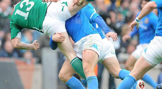 Brian O'Driscoll is upended by Italy's Gonzalo Garcia, who was subsequently sin-binned. BRENDAN MORAN / SPORTSFILE