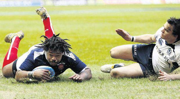 France's Mathieu Bastareaud dives over to score a try against Scotland during yesterday's Six Nations clash at Murrayfield