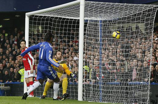 Didier Drogba smashes home his and Chelsea's second goal in his side's victory over Arsenal that returned them to the top of the Premier League yesterday Photo: Getty Images