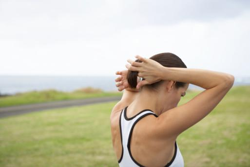 Woman tying hair back before running