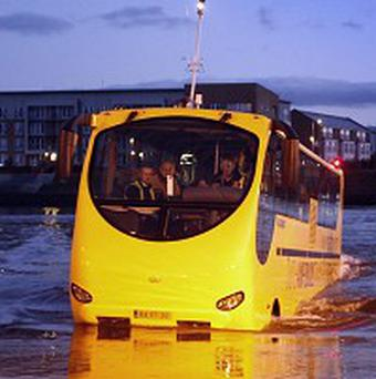 The amphibious bus emerges from the River Clyde during trials