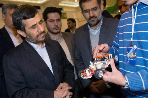 A student explains his invention to Iran's President Mahmoud Ahmadinejad (on left) during the National Festival of Innovation and Prosperity in Tehran yesterday